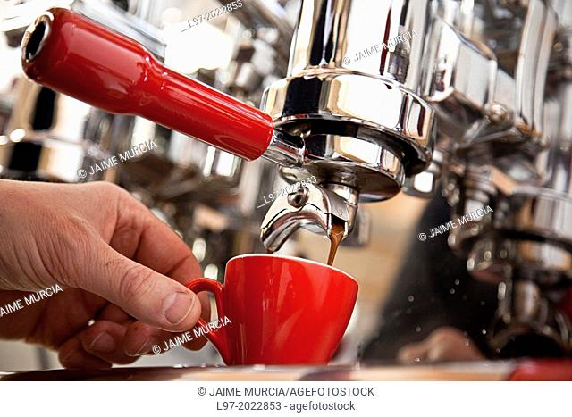 Person making fresh coffee with expresso machine
