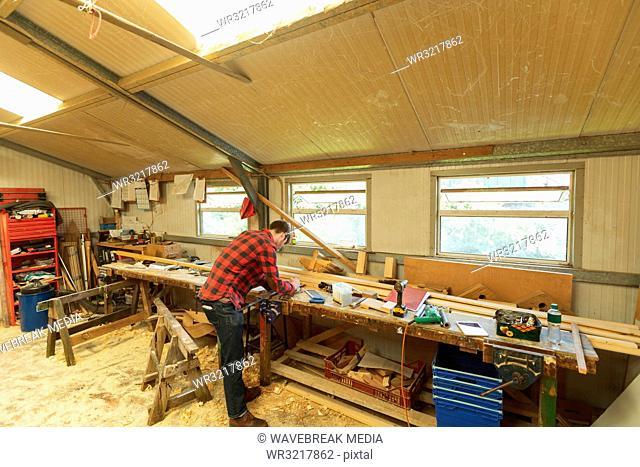 Male carpenter working in workshop
