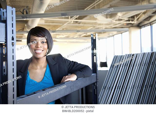 African American businesswoman standing in empty office