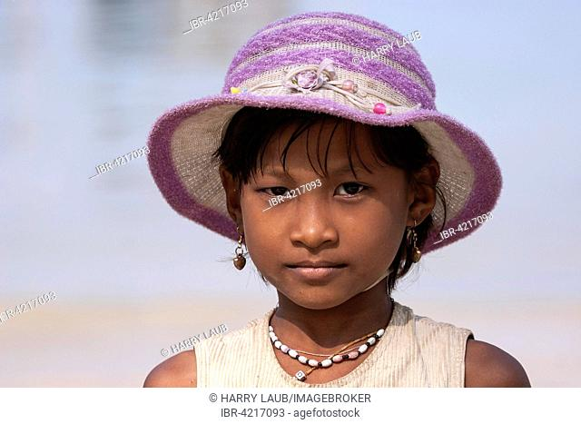 Local girl with pink hat, earrings and necklace, portrait, Ngapali, Thandwe, Rakhine State, Myanmar