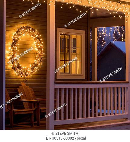 Fairy lights and Christmas wreath on house