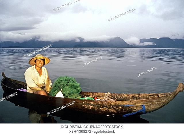 fisherman with dugout on the lake Maninjau, Sumatra island, Republic of Indonesia, Southeast Asia and Oceania