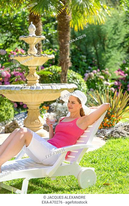 Woman relaxing on deck chair