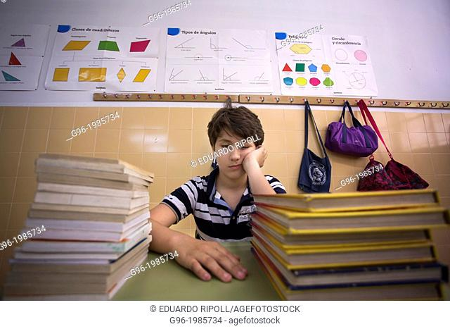Boy bored at the school