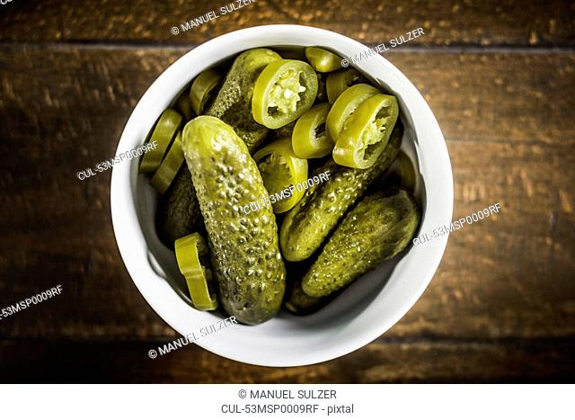 Bowl of pickles and chili pepper slices
