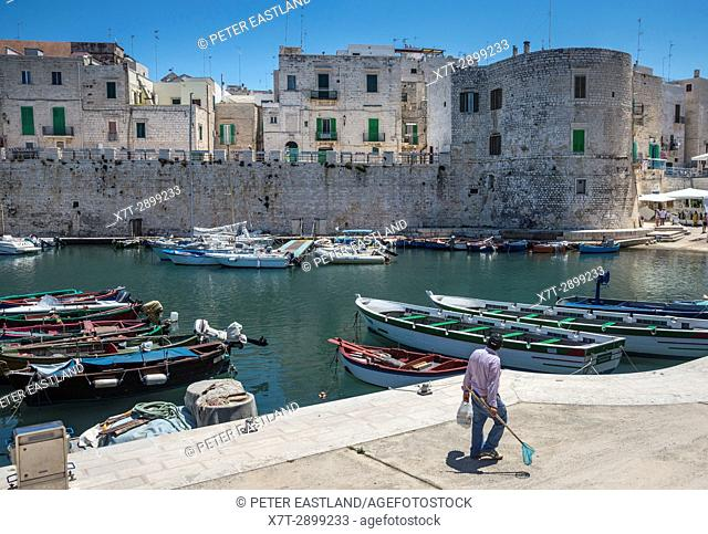 Fishing boats in the inner harbour at the old town of Giovinazzo, Puglia, Southern Italy