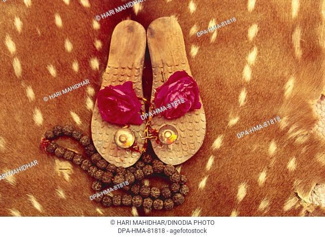 concept , wooden footwear khadau used for sadhu saint , india