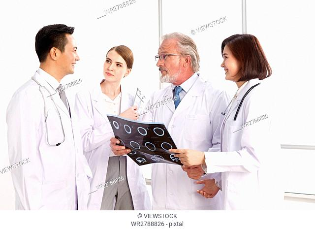 Doctors examining x-ray report in hospital