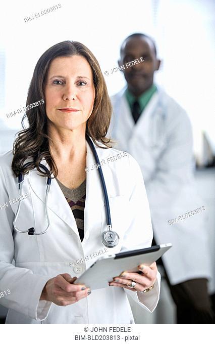 Doctors standing in office