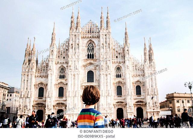 Boy looking at Milan Cathedral, Milan, Lombardy, Italy