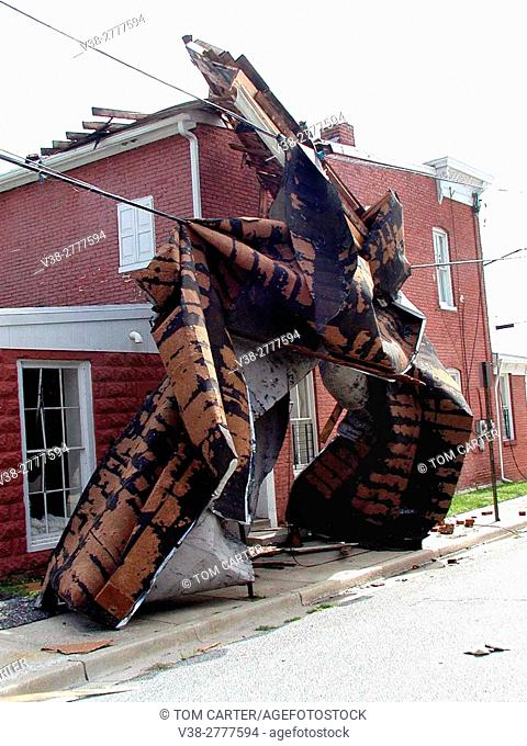 piece of a building wrapped around another building following a tornado