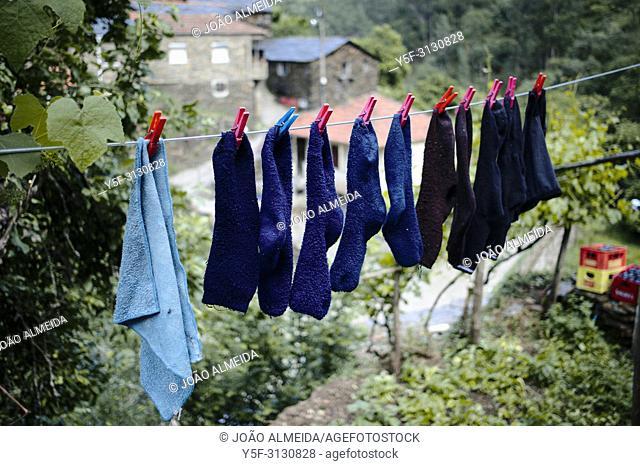 Socks drying in a clothesline