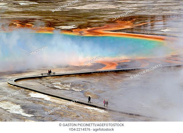 People walking on path at Grand Prismatic Spring, Midway Geyser Basin, Yellowstone National Park, Wyoming/Montana/Idaho, USA