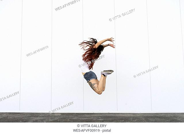 Young acrobat jumping in air