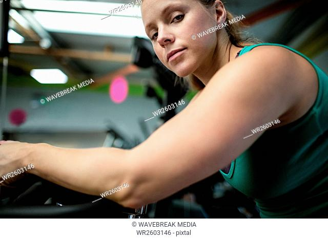 Pregnant woman working out on exercise bike