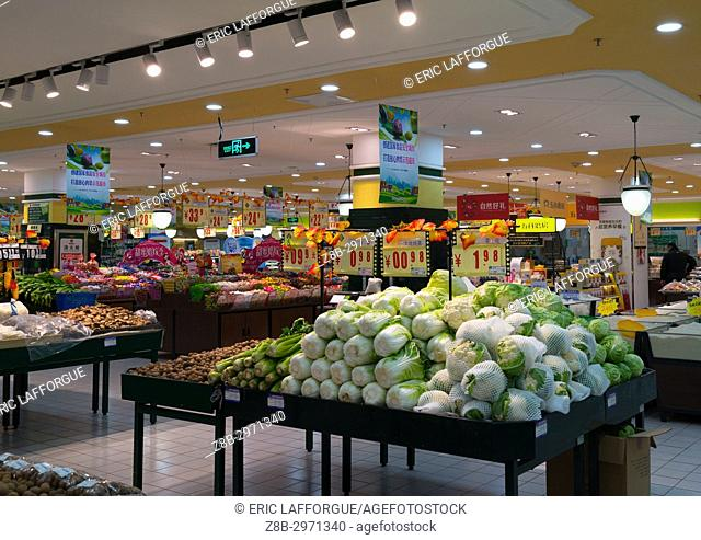 Vegetables and fruits section of supermarket, Gansu province, Linxia, China