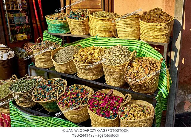 Baskets of dried flowers, rose petals, buds and herbs in the souk. Morocco