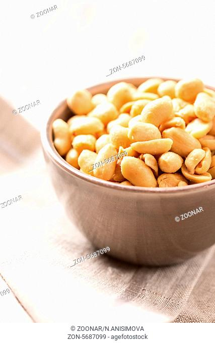 Processed peanuts in a bowl on tablecloth