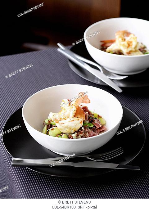 Bowls of prawns, broadbeans and rice