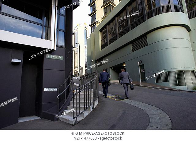 business people walk in Sydney central business district, Australia