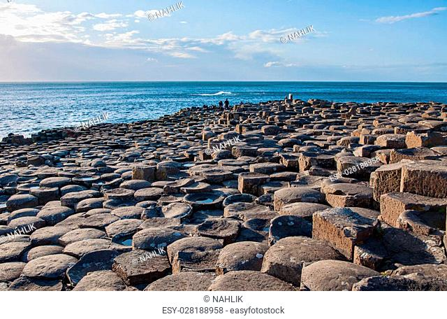 Giants Causeway. Unique natural geological formation of hexagonal volcanic basalt rocks and stones on the coast of Antrim County, Northern Ireland