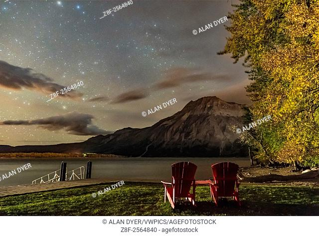 A nightscape scene at Linnet Lake area in Waterton Lakes National Park, looking east over Upper Waterton Lake and toward Vimy Peak