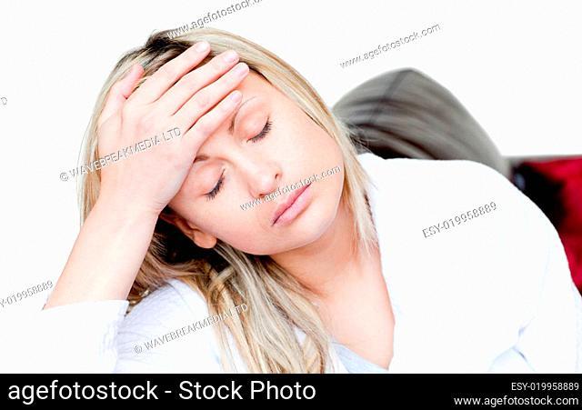 Tiring woman sitting on a sofa