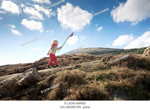 Boy carrying flag, Fairy Pools, Isle of Skye, Hebrides, Scotland