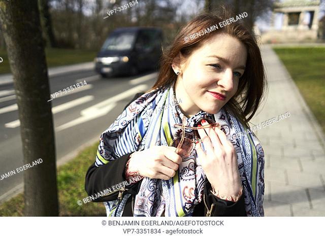 woman walking at street, in Munich, Germany