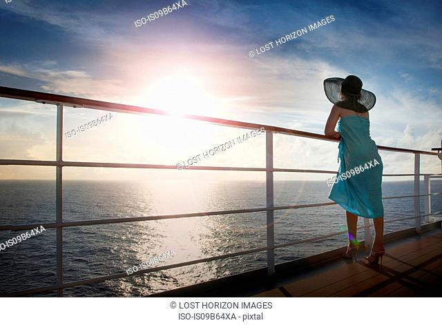 Woman leaning on railings, looking at view, rear view, Abercorn, Acklins and Crooked Islands, Bahamas, North America