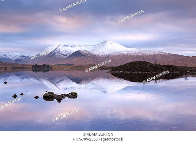 Snow covered Black Mount reflected in a lochan, Rannoch Moor, Highlands, Scotland, United Kingdom, Europe