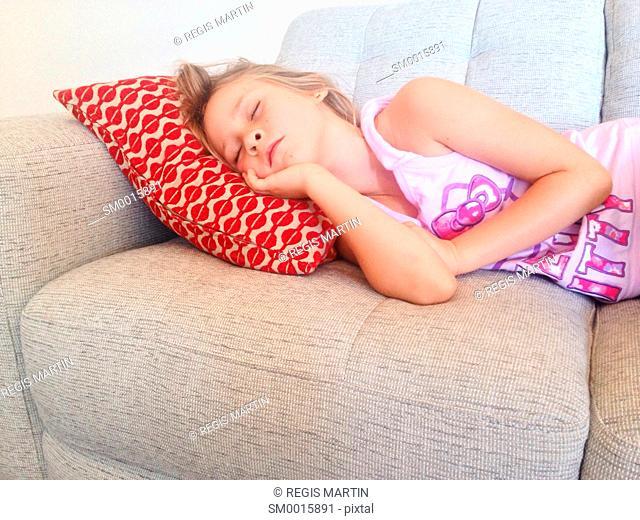 Young girl sleeping on a sofa