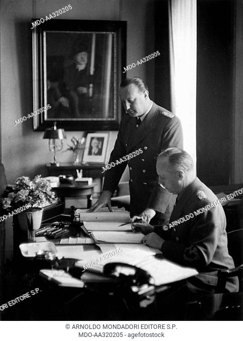 Joachim von Ribbentrop and Walther Hewel in Berlin. The German Foreign Minister Joachim von Ribbentrop at a desk in his office in Wilhelmstrasse with the Chief...