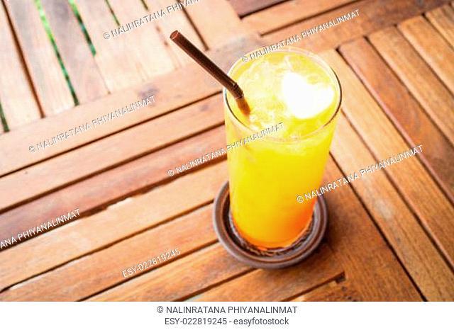 Romantic orange juice with heart ice cube