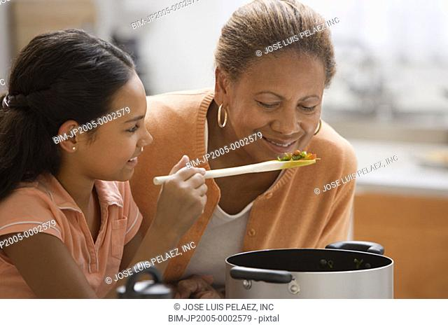 Mother smelling cooking food