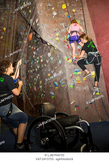 Woman with spinal cord injury rock climbing; Edmonton, Alberta, Canada