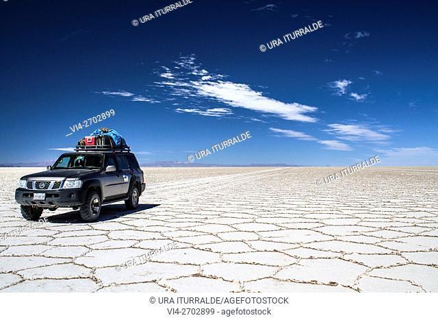 Jeep carrying tourists through the Uyuni Salt Flats, Bolivia