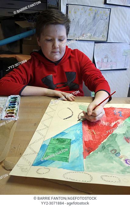 6th Grade Boy Painting in Art Class, Wellsville, New York, USA