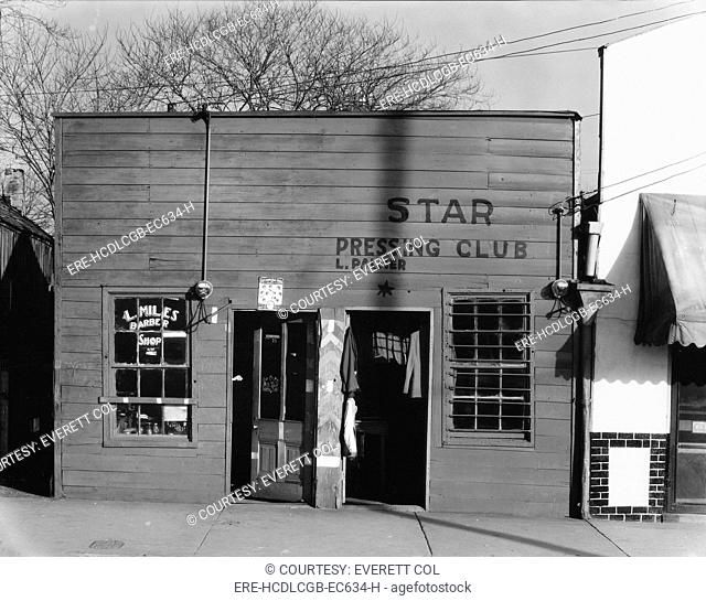 African American store fronts, original title: 'Shop fronts, laundry and barber shop, Negro shop', Vicksburg, Mississippi, photograph by Walker Evans, February