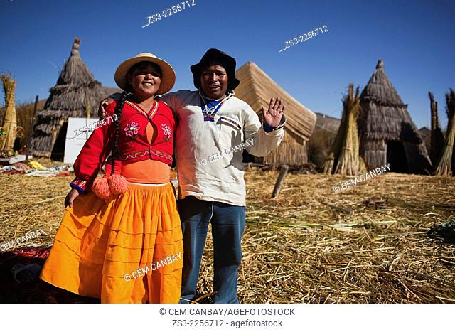 Young Aymara couple at Uros Islands, Lake Titicaca, Puno Region, Peru, South America