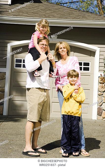 Family portrait outside house
