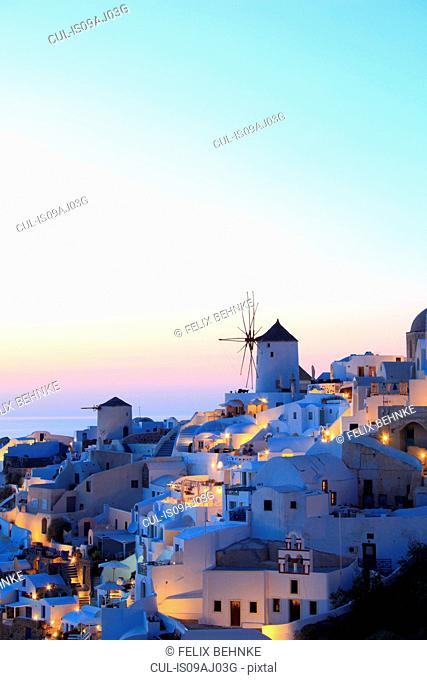 Oia town and windmill at dusk, Santorini, Cyclades Islands, Greece