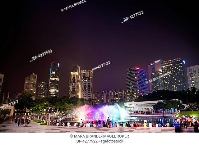 People watching light show, water fountain, Lake Symphony, city park, skyscrapers, City Centre, Kuala Lumpur, Malaysia