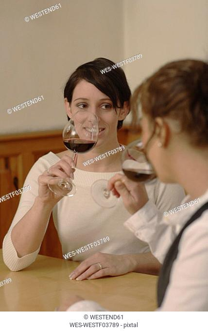Two women testing wine