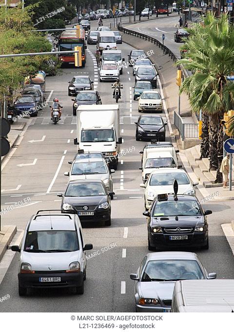 Traffic jam. Cars, trucks and motorcycles in Travessera de Dalt. Gràcia quarter, Barcelona, Catalonia, Spain