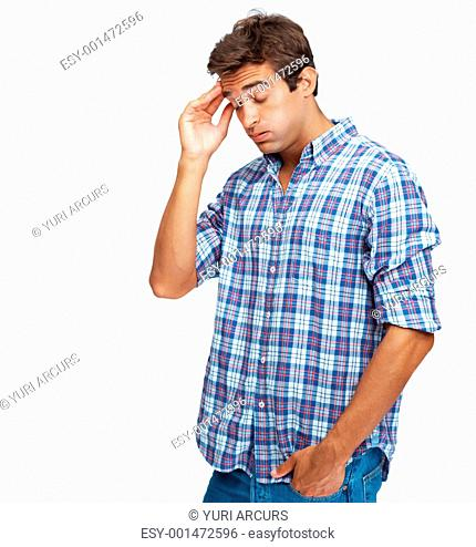 Unhappy young man with terrible headache standing over white background