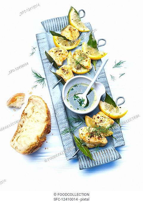 Monkfish skewers with lemon sauce
