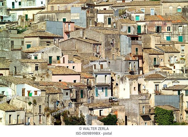 Detail of traditional house exteriors and rooftops, Ragusa, Sicily, Italy
