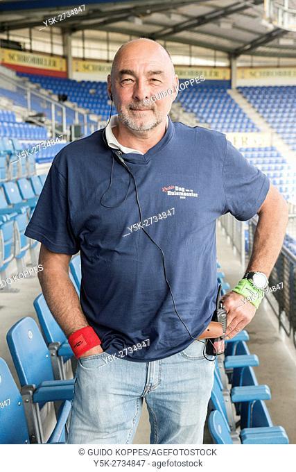 Tilburg, Netherlands. Middle aged balding caretaker, portrait, on a football stadium's tribune