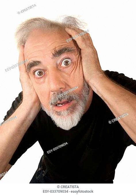 Paranoid older white man covering his ears